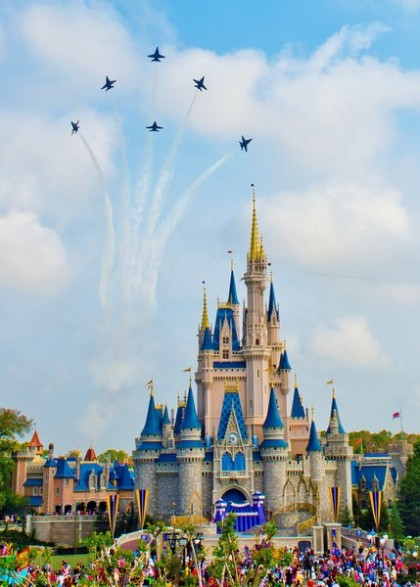 150319-N-KG934-082  ORLANDO, Fla. (March 19, 2015) -- The U.S. Navy Flight Demonstration Squadron, the Blue Angels, execute the Delta Breakout over the Cinderella Castle in the Magic Kingdom at Walt Disney World en route to the Melbourne Air and Space Show March 19. The Blue Angels are scheduled to fly in 68 performances at 35 locations in 2015.  (U.S. Navy photo by Mass Communication Specialist 1st Class Terrence Siren/RELEASED)