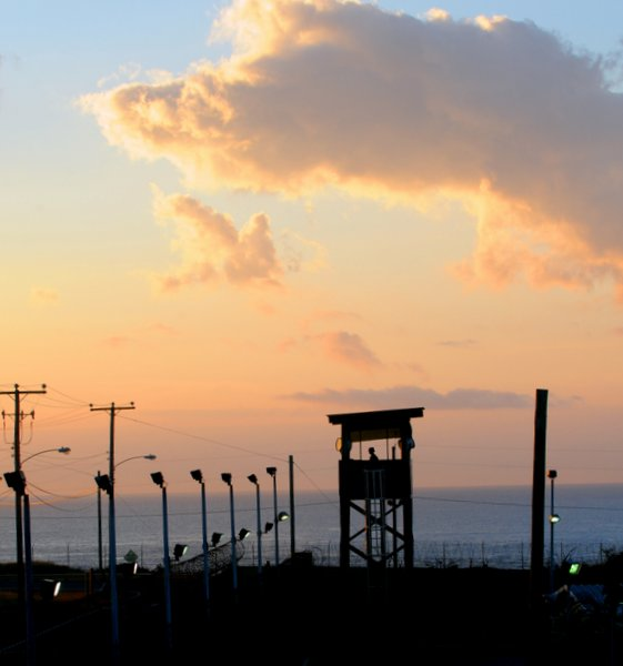 GUANTANAMO BAY, Cuba – Spc. Emely Nieves from the Puerto Rico Army National Guard guards her post over the Joint Task Force Guantanamo detention facility at sunrise, Jan. 7. JTF Guantanamo provides safe, humane, legal and transparent care and custody of detainees, including those convicted by military commission and those ordered released by a court. The JTF conducts intelligence collection, analysis and dissemination for the protection of detainees and personnel working in JTF Guantanamo facilities and in support of the War on Terror. JTF Guantanamo provides support to the Office of Military Commissions, to law enforcement and to war crimes investigations. The JTF conducts planning for and, on order, responds to Caribbean mass migration operations. (JTF Guantanamo photo by U.S. Air Force Senior Airman Gino Reyes) UNCLASSIFIED – Cleared for public release. For additional information contact JTF Guantanamo PAO 011-5399-3589; DSN 660-3589 www.jtfgtmo.southcom.mil